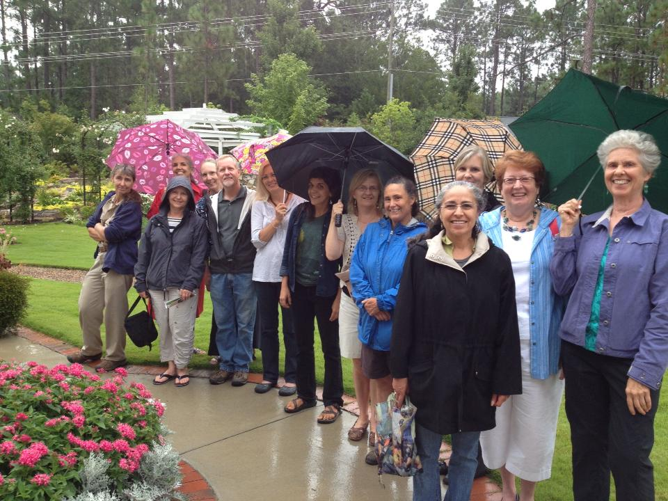 Horticulture therapy volunteers in the garden on a rainy day