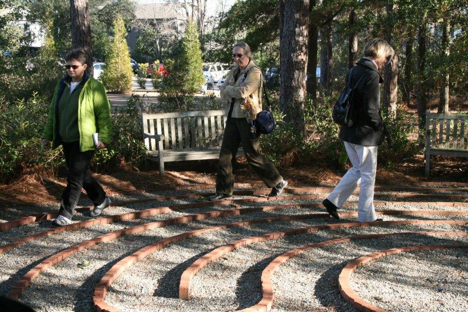 People walking in a meditation garden